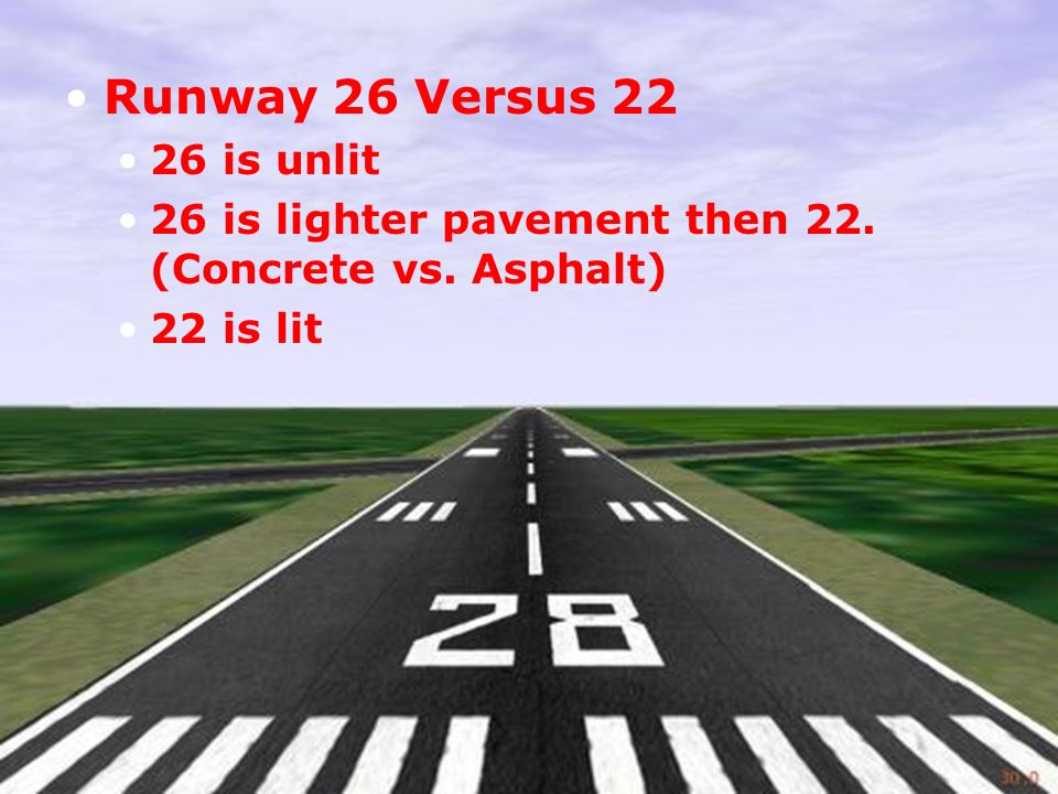 Runway 26 Versus is unlit 26 is lighter pavement then 22. (Concrete vs. Asphalt) 22 is lit