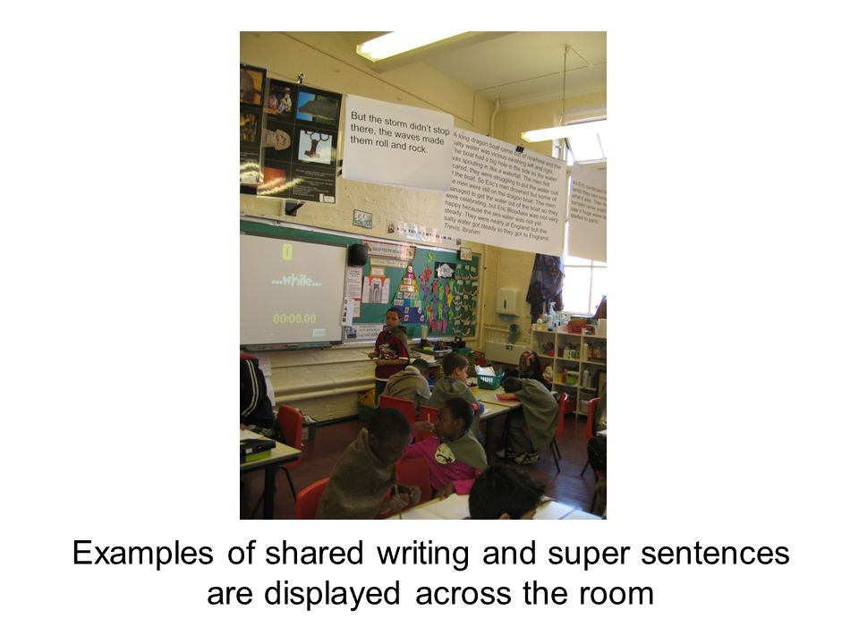 Examples of shared writing and super sentences are displayed across the room