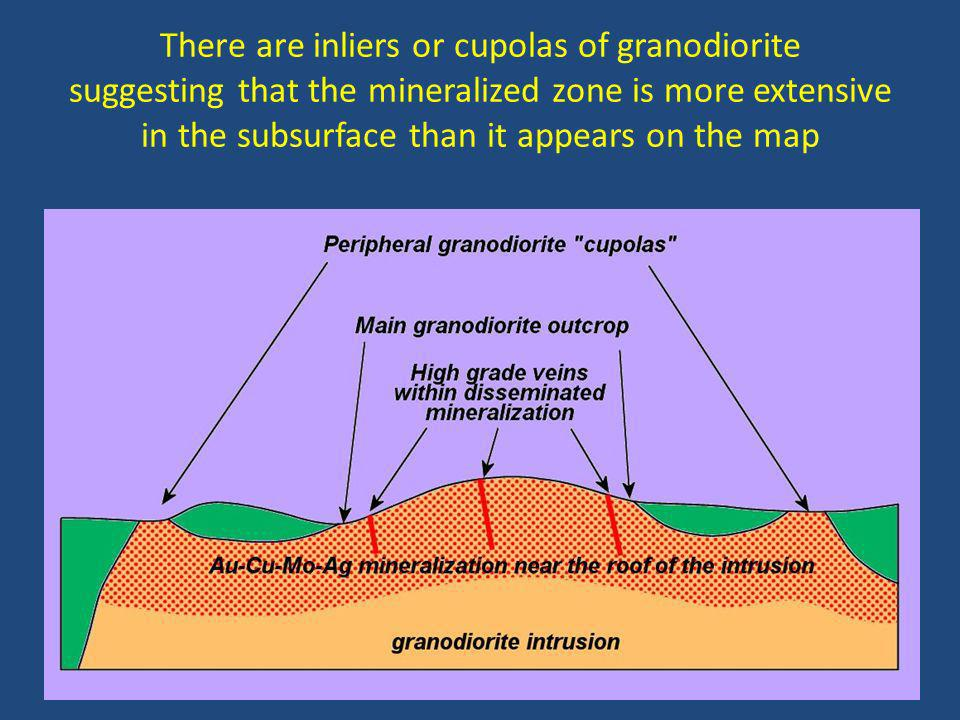 There are inliers or cupolas of granodiorite suggesting that the mineralized zone is more extensive in the subsurface than it appears on the map