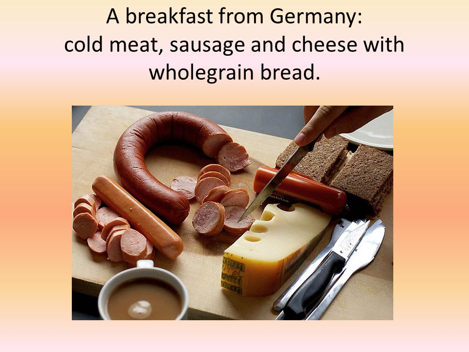 A breakfast from Germany: cold meat, sausage and cheese with wholegrain bread.