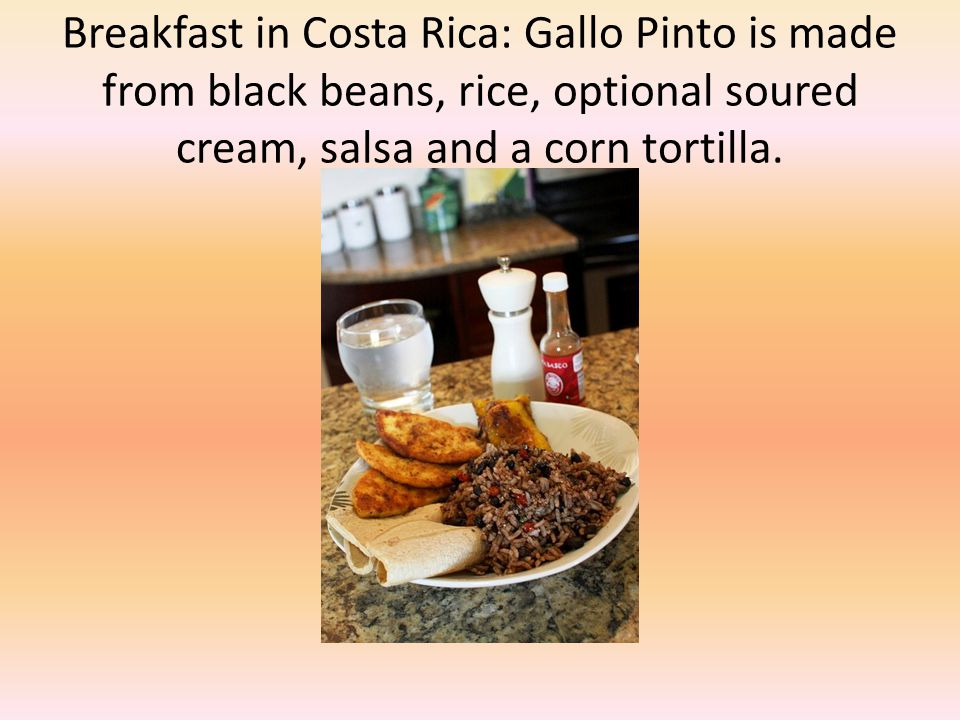 Breakfast in Costa Rica: Gallo Pinto is made from black beans, rice, optional soured cream, salsa and a corn tortilla.