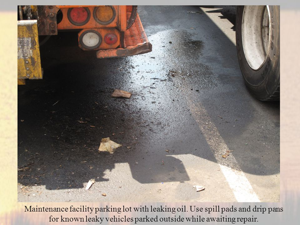 Maintenance facility parking lot with leaking oil.