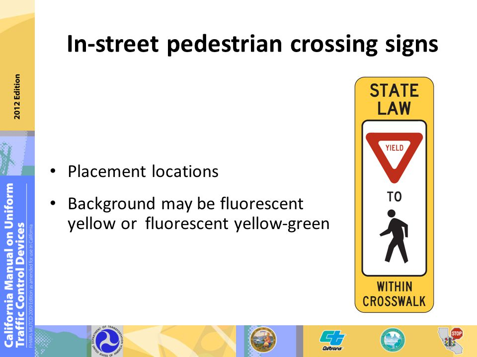 In-street pedestrian crossing signs Placement locations Background may be fluorescent yellow or fluorescent yellow-green