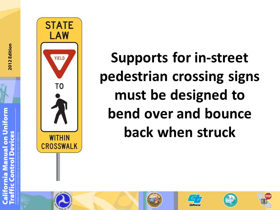Supports for in-street pedestrian crossing signs must be designed to bend over and bounce back when struck