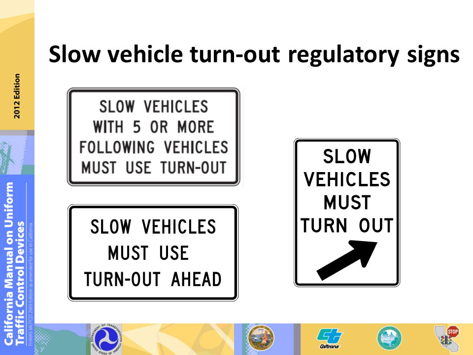 Slow vehicle turn-out regulatory signs