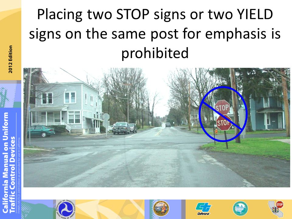 Placing two STOP signs or two YIELD signs on the same post for emphasis is prohibited