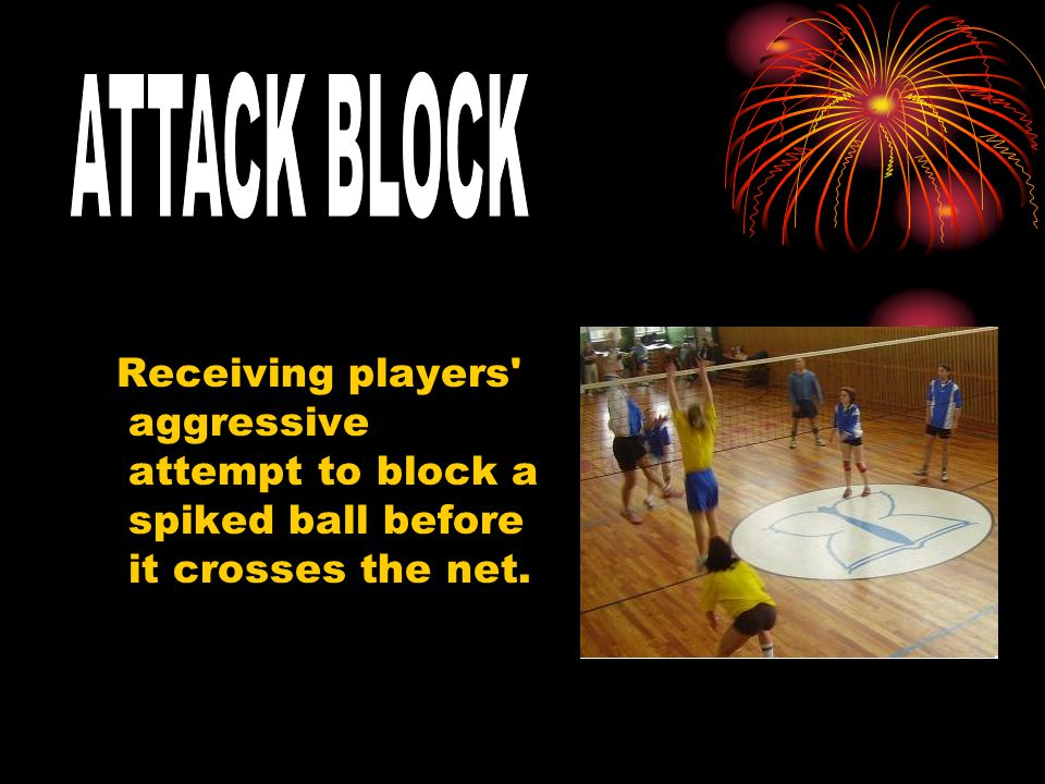 Receiving players aggressive attempt to block a spiked ball before it crosses the net.