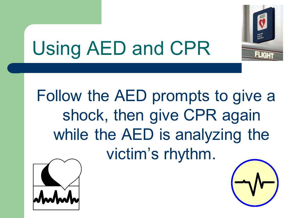Follow the AED prompts to give a shock, then give CPR again while the AED is analyzing the victim's rhythm.