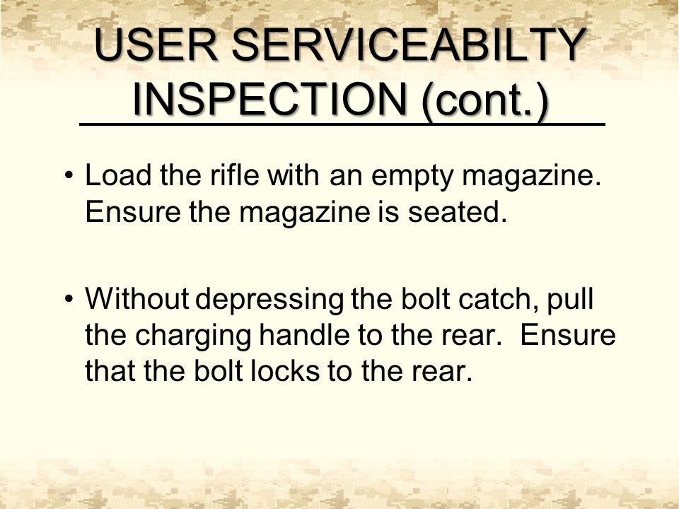 Load the rifle with an empty magazine. Ensure the magazine is seated.