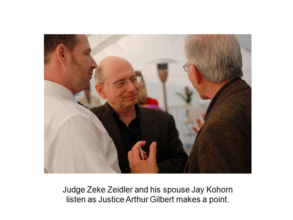. Judge Zeke Zeidler and his spouse Jay Kohorn listen as Justice Arthur Gilbert makes a point.