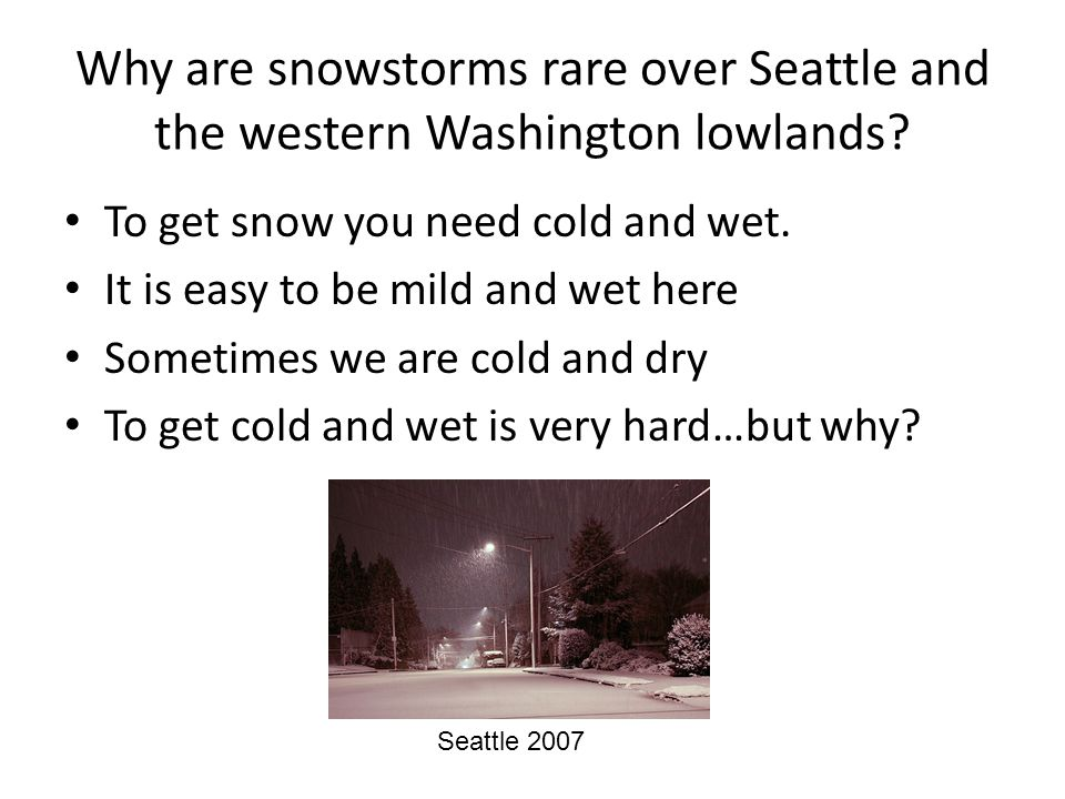 Why are snowstorms rare over Seattle and the western Washington lowlands.
