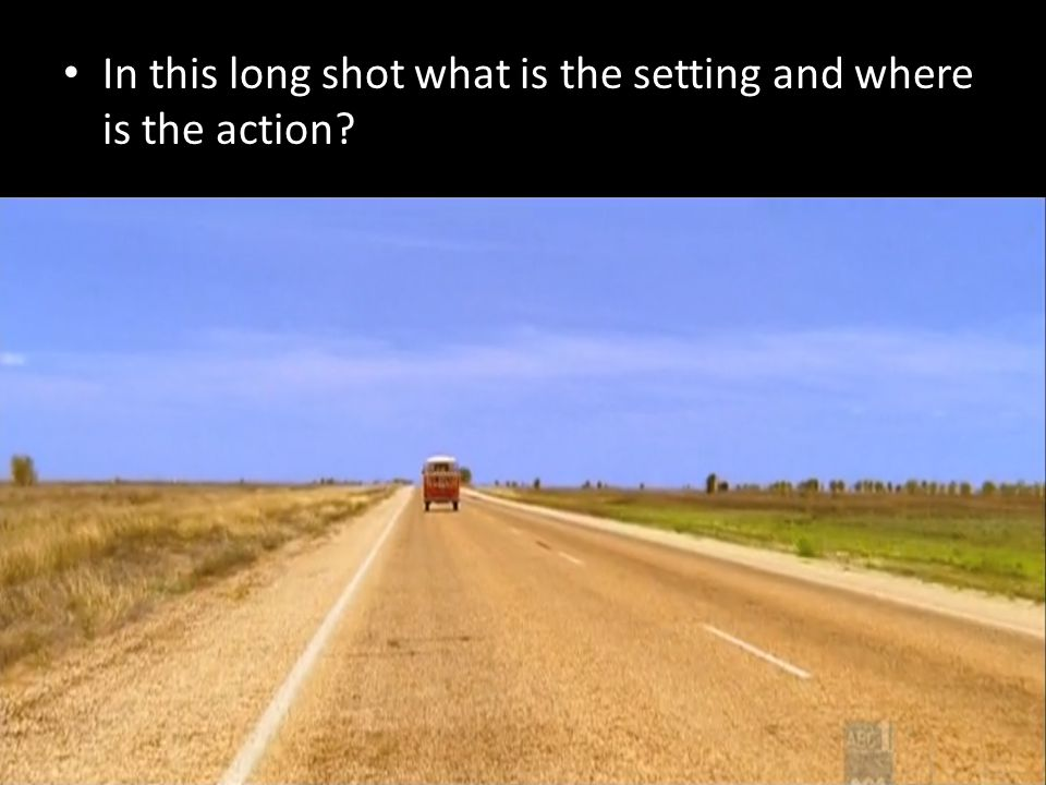 In this long shot what is the setting and where is the action