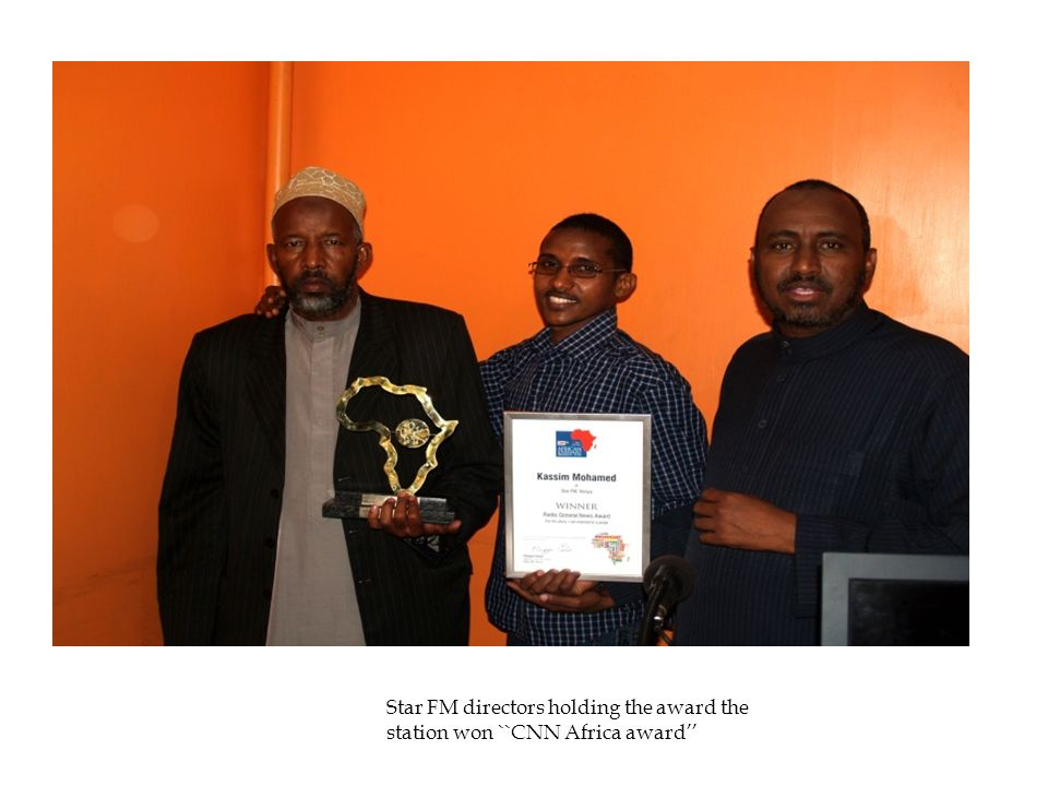 Star FM directors holding the award the station won ``CNN Africa award''