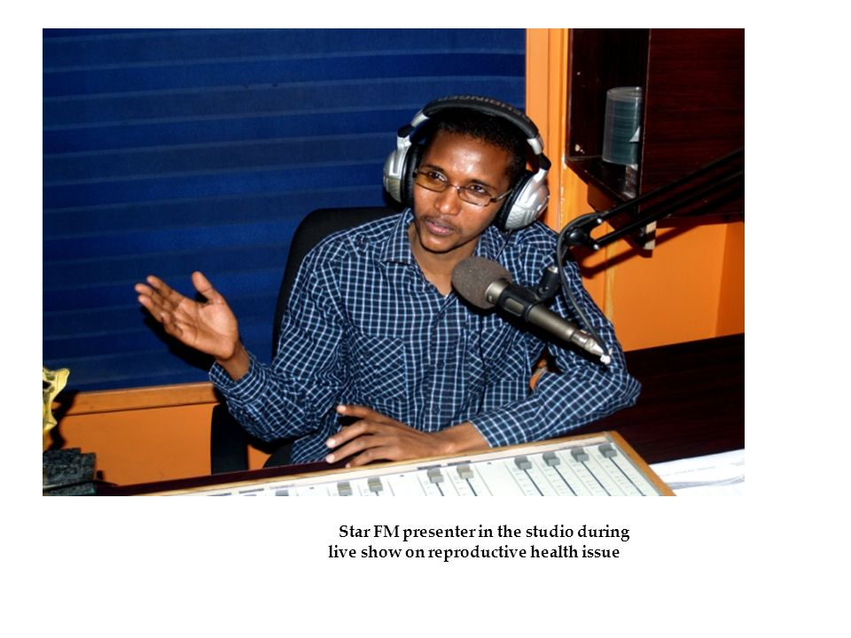5 Star FM presenter in the studio during live show on reproductive health issue.