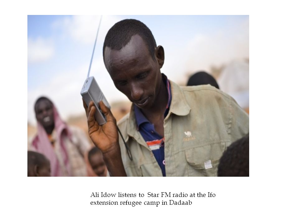 Ali Idow listens to Star FM radio at the Ifo extension refugee camp in Dadaab daab.