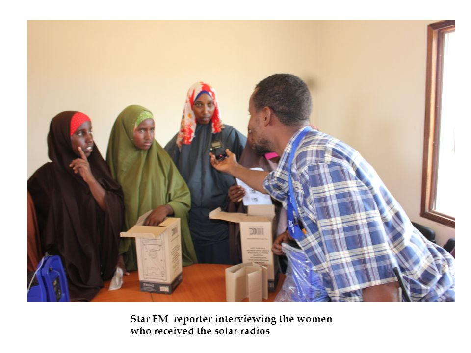 Star FM reporter interviewing the women who received the solar radios daab.