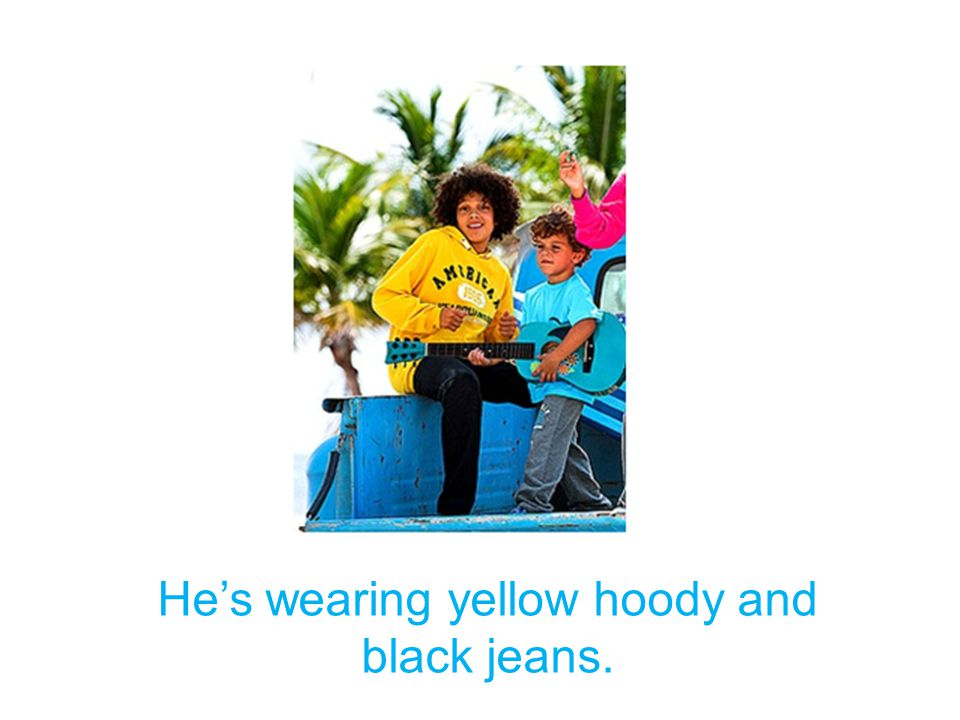 He's wearing yellow hoody and black jeans.
