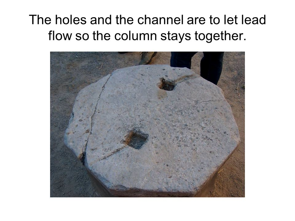The holes and the channel are to let lead flow so the column stays together.