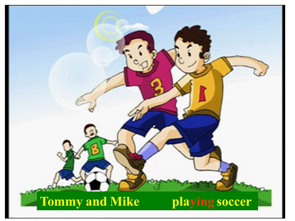 Tommy and Mike playing soccer