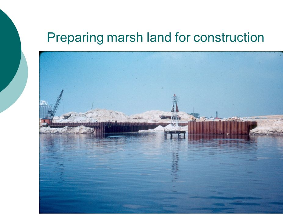 Preparing marsh land for construction