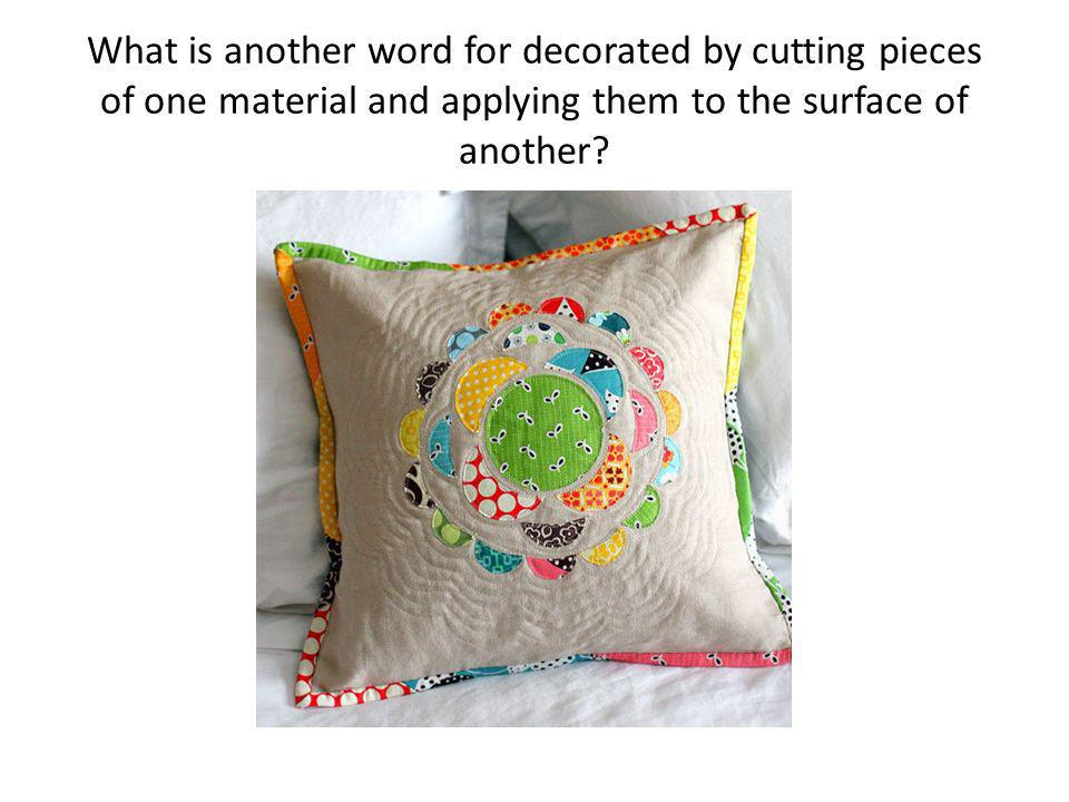 What is another word for decorated by cutting pieces of one material and applying them to the surface of another