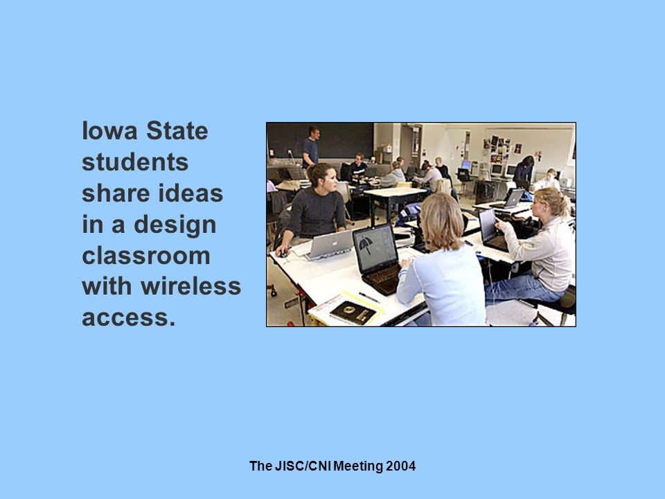 The JISC/CNI Meeting 2004 Iowa State students share ideas in a design classroom with wireless access.