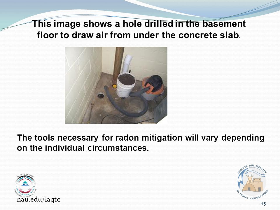 This image shows a hole drilled in the basement floor to draw air from under the concrete slab.