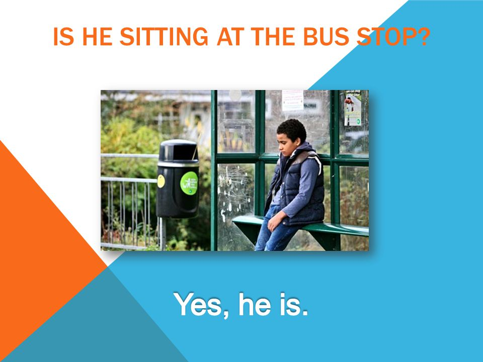 IS HE SITTING AT THE BUS STOP