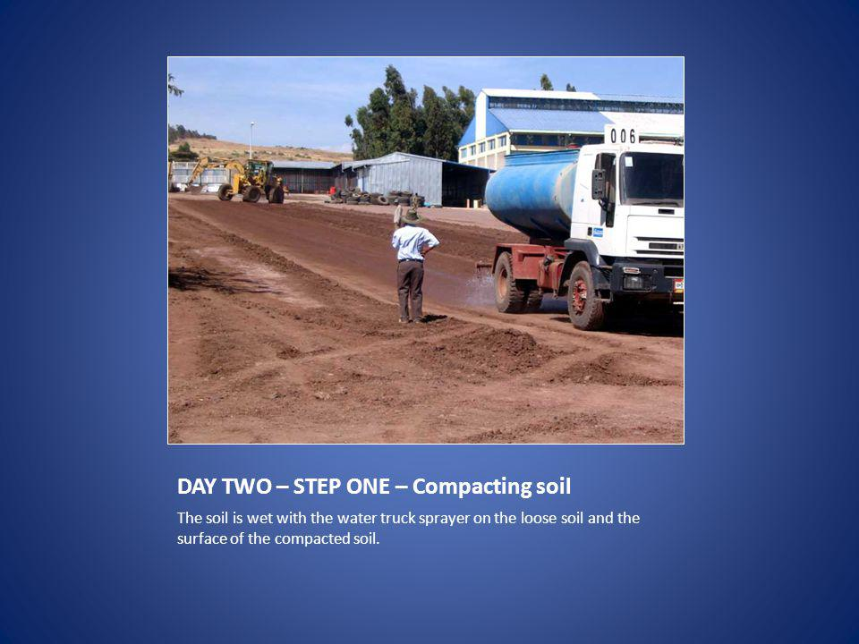 DAY TWO – STEP ONE – Compacting soil The soil is wet with the water truck sprayer on the loose soil and the surface of the compacted soil.