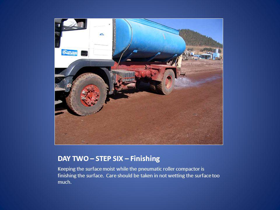 DAY TWO – STEP SIX – Finishing Keeping the surface moist while the pneumatic roller compactor is finishing the surface.