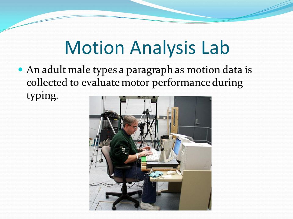Motion Analysis Lab An adult male types a paragraph as motion data is collected to evaluate motor performance during typing.