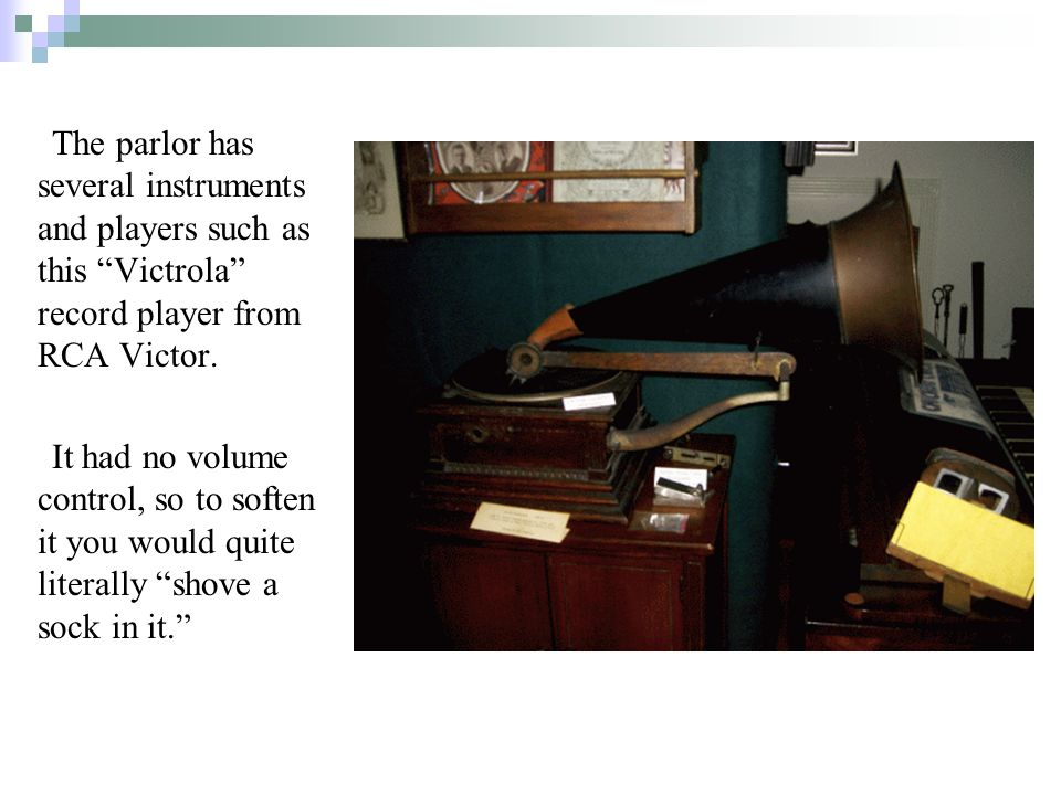 The parlor has several instruments and players such as this Victrola record player from RCA Victor.