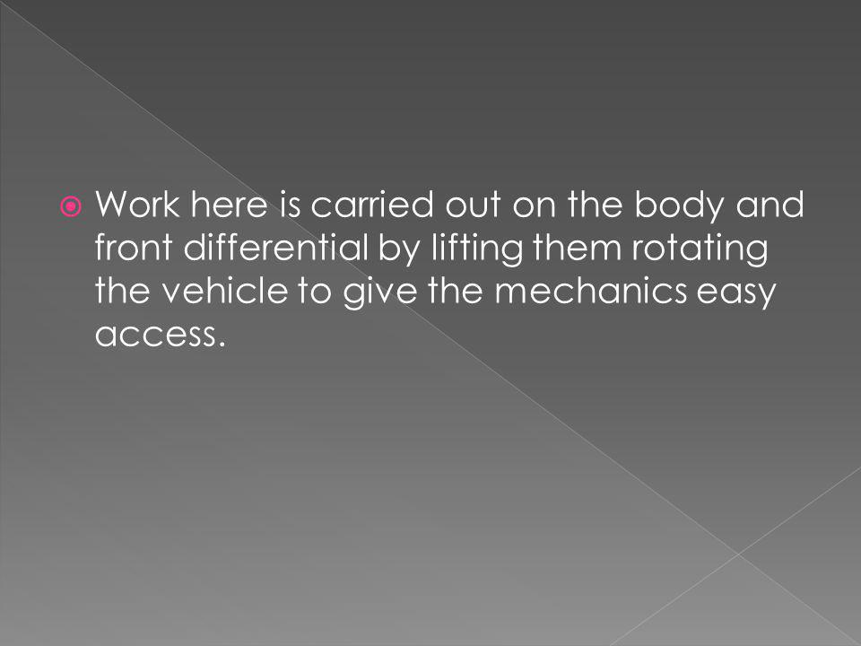 Work here is carried out on the body and front differential by lifting them rotating the vehicle to give the mechanics easy access.