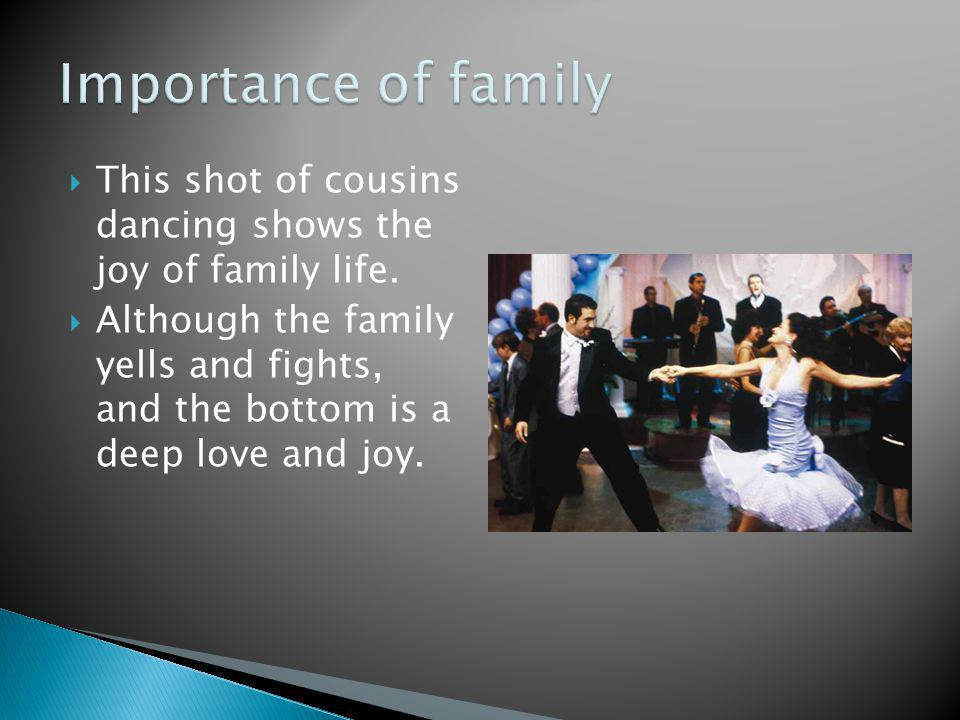 This shot of cousins dancing shows the joy of family life.