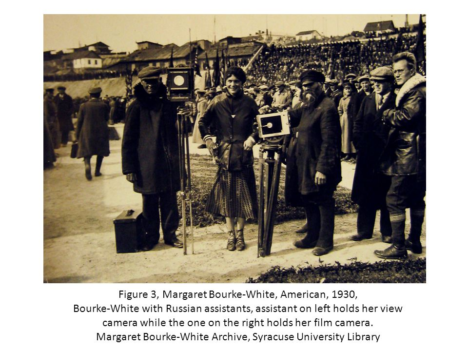 Figure 3, Margaret Bourke-White, American, 1930, Bourke-White with Russian assistants, assistant on left holds her view camera while the one on the right holds her film camera.