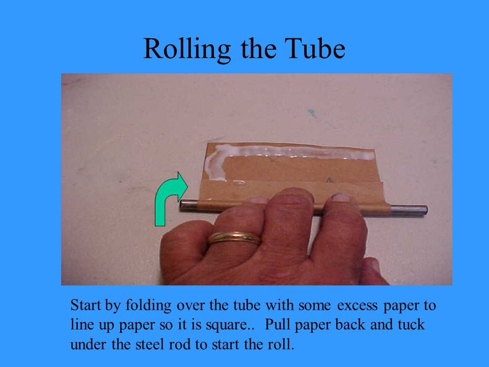 Rolling the Tube Start by folding over the tube with some excess paper to line up paper so it is square..