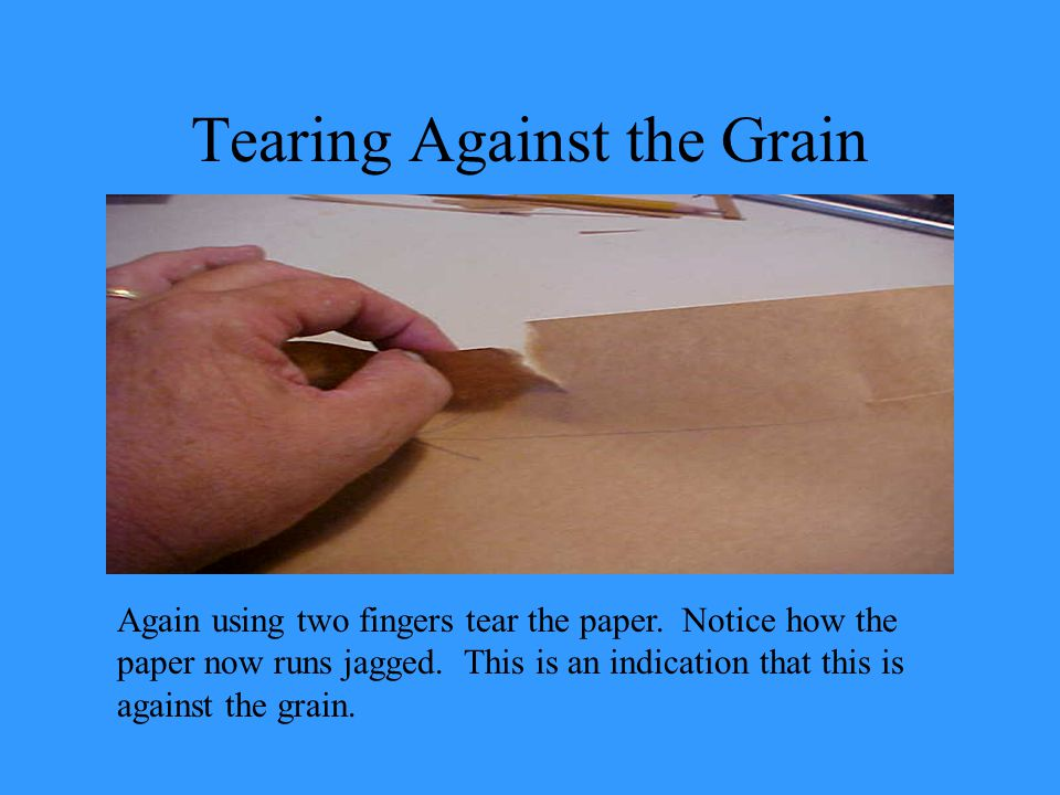 Tearing Against the Grain Again using two fingers tear the paper.
