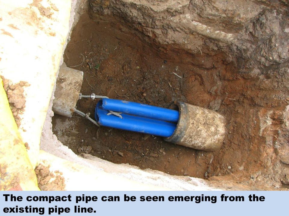 The compact pipe can be seen emerging from the existing pipe line.