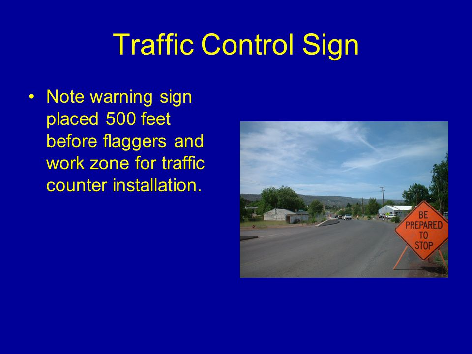 Traffic Control Sign Note warning sign placed 500 feet before flaggers and work zone for traffic counter installation.