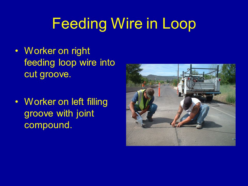 Feeding Wire in Loop Worker on right feeding loop wire into cut groove.