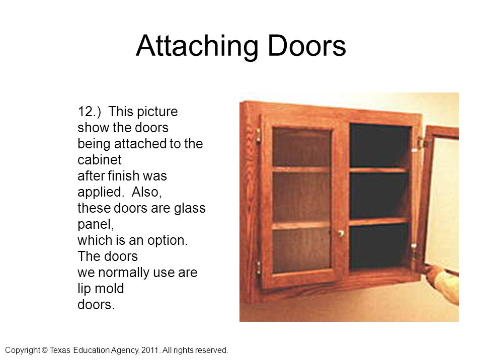 Attaching Doors 12.) This picture show the doors being attached to the cabinet after finish was applied.