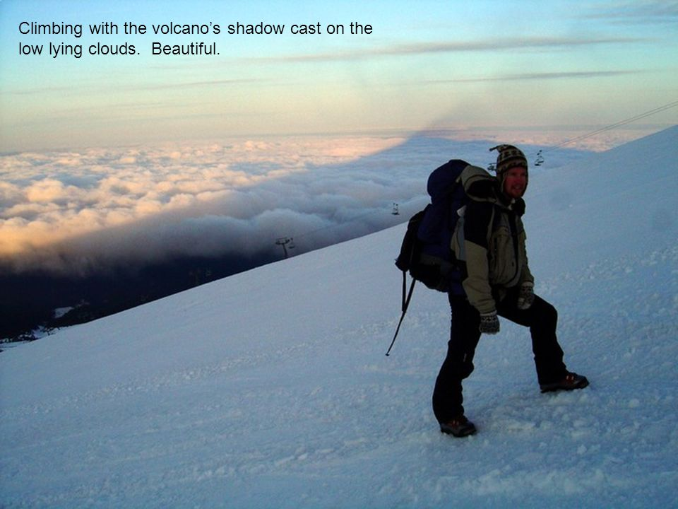 Climbing with the volcanos shadow cast on the low lying clouds. Beautiful.