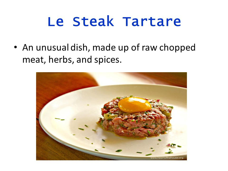 Le Steak Tartare An unusual dish, made up of raw chopped meat, herbs, and spices.