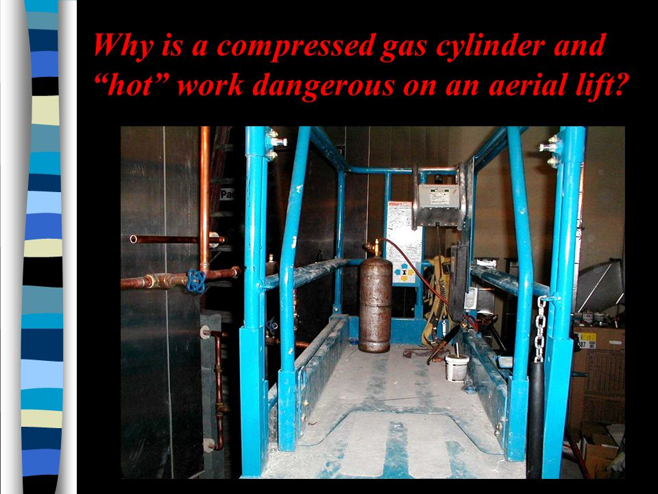 Why is a compressed gas cylinder and hot work dangerous on an aerial lift