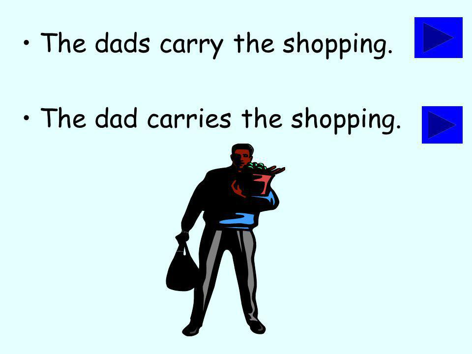 The dads carry the shopping. The dad carries the shopping.