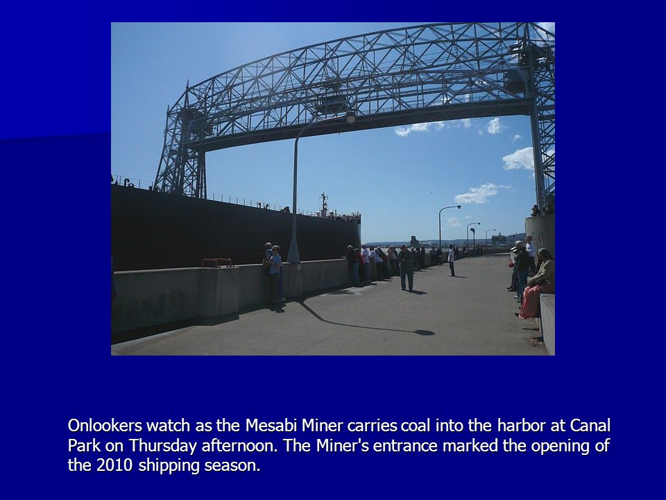 Onlookers watch as the Mesabi Miner carries coal into the harbor at Canal Park on Thursday afternoon.