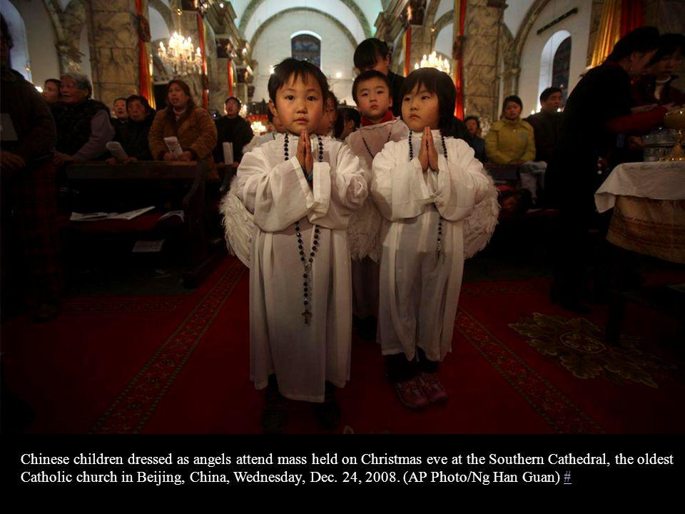 Iraqi Christians attend Christmas Mass at the Virgin Mary church on December 25, 2008 in Baghdad, Iraq.