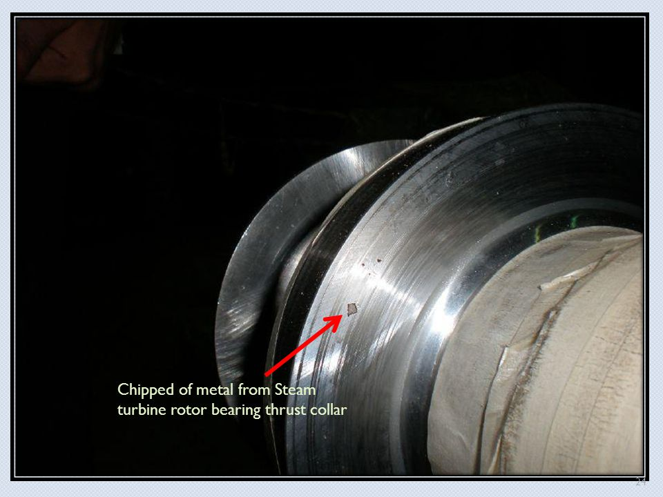 Chipped of metal from Steam turbine rotor bearing thrust collar 24