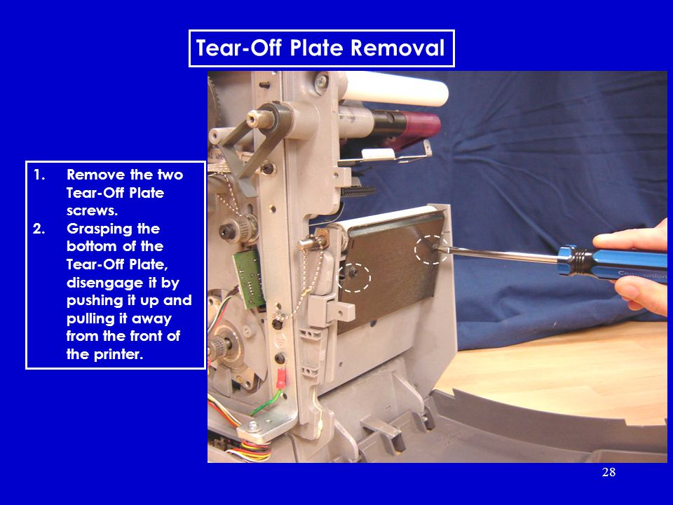 28 Tear-Off Plate Removal 1.Remove the two Tear-Off Plate screws.