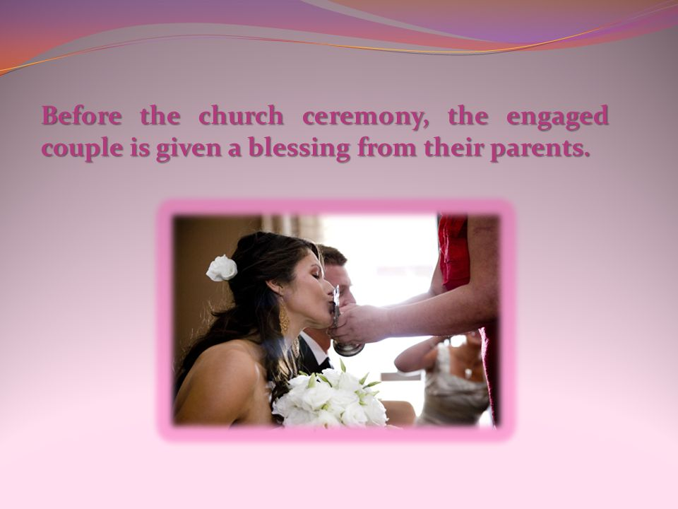 Before the church ceremony, the engaged couple is given a blessing from their parents.